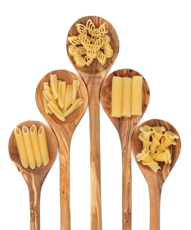 Pasta varieties of penne, fiorelli, algar,rigatoni and casarecce in olive wood spoons over white background Stock Photo - 17817725