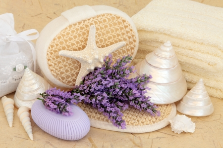Lavender herb flowers with bathroom and spa accessories of towels and exfoliating body scrub over mottled cream background Stock Photo - 18020702
