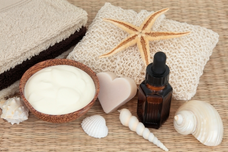 Natural skincare products with coconut soap,  moisturising cream, aromatherapy essential oil  and bathroom accessories Stock Photo - 18020122