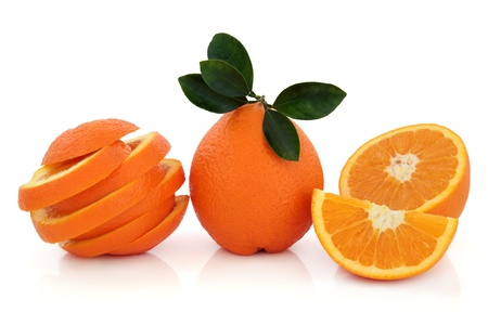 Orange fruit whole and sliced with leaf sprig over white background Stock Photo - 18020120