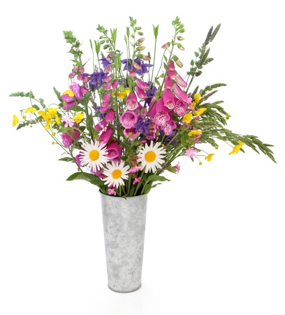 Spring wildflower and grass variety arrangement in an aluminium vase over white background  Stock Photo - 18032475