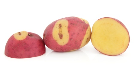 Apache potato whole and sliced over white background  Stock Photo - 18032479