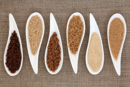 Sugar varieties in white dishes over hessian background Stock Photo - 18032485