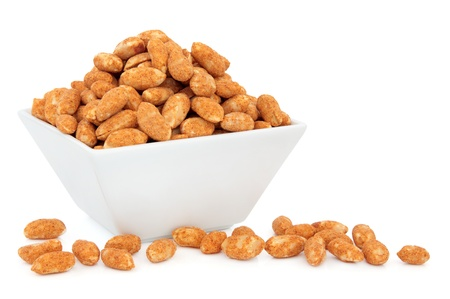 Roasted peanuts in a white porcelain dish over white background Stock Photo - 18305431