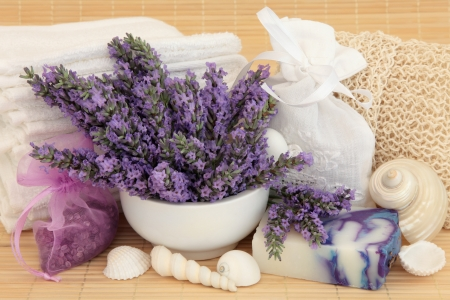 Lavender herb flower sprigs, soap, bath crystals and spa accessories over bamboo background  Stock Photo - 18305443