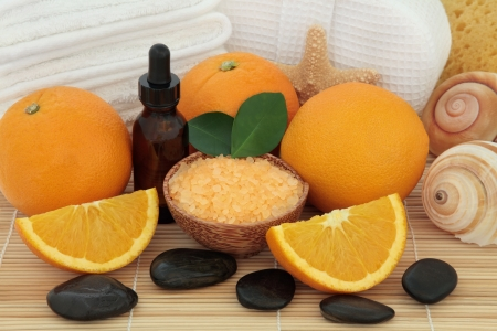 Spa and aromatherapy accessories with orange fruit over bamboo background Stock Photo - 18305442