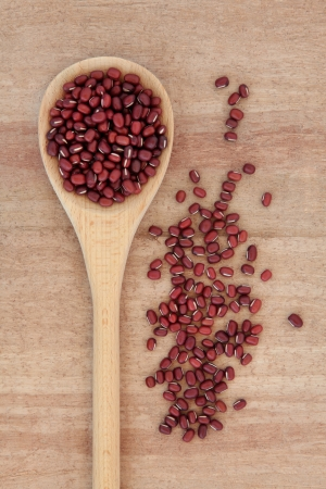Adzuki beans in a wooden spoon over papyrus background Stock Photo - 18305450