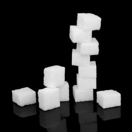 White sugar cubes over black background  Stock Photo - 18305426