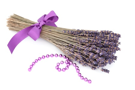 Lavender herb flower posy with lilac bead strand over white background  Lavandula Stock Photo - 18305435