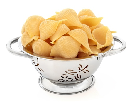 Conchiglioni rigati pasta in stainless steel colander over white background  Stock Photo - 18305433