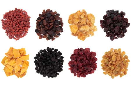 Goji berry, sultana, pineapple, cranberry, mango, elderberry, cherry and golden raisin dried fruit over white background  Stock Photo - 18305437