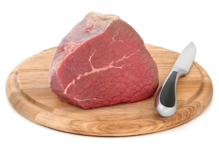 Silverside of beef meat joint on a carving board with knife over white background Stock Photo - 18424157