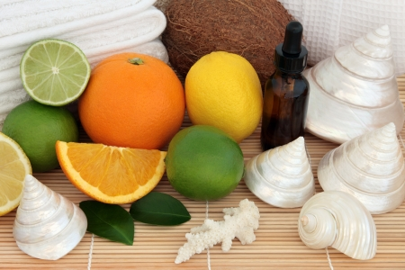 Spa and aromatherapy accessories  with lemon, lime, coconut and orange fruit over bamboo background  Stock Photo - 18422907
