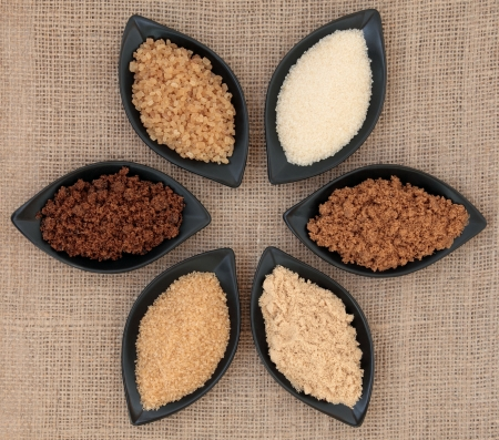 Sugar varieties in black dishes over hessian background Stock Photo - 18424171