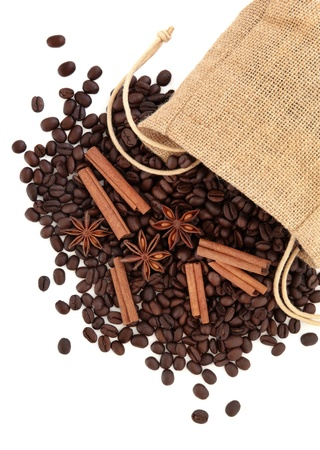 Coffee beans, cinnamon sticks with star anise spice in a hessian drawstring sack  over white background  Stock Photo - 18424168
