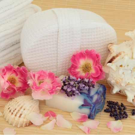 Spa and bathroom accessory still life with lavender and rose flowers over bamboo background  Stock Photo - 18571125