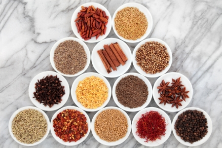 Large herb and spice selection in white bowls over marble background  Stock Photo - 18571129