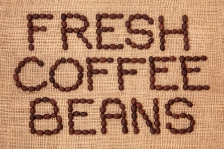 Coffee bean design in word form on a hessian background  Stock Photo - 18571132