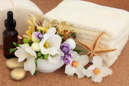 Aromatherapy and spa accessories with  freesia, syringa rose, honeysuckle and lavender flowers   Stock Photo - 18918477