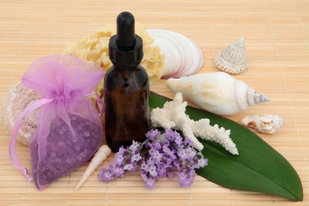 Lavender herb flowers, with aromatherapy essential oil bottle and bathroom accessories  Stock Photo - 18881754