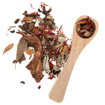 Chinese herbal medicine mixture with wooden spoon over white backgorund  Stock Photo