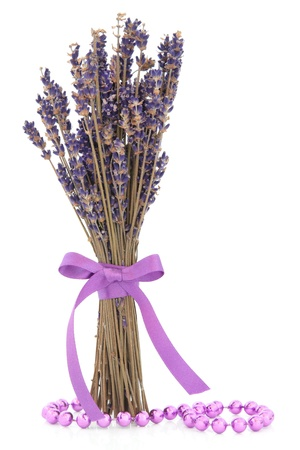 Lavender herb flower posy with lilac bead strand over white background  Stock Photo - 18881727