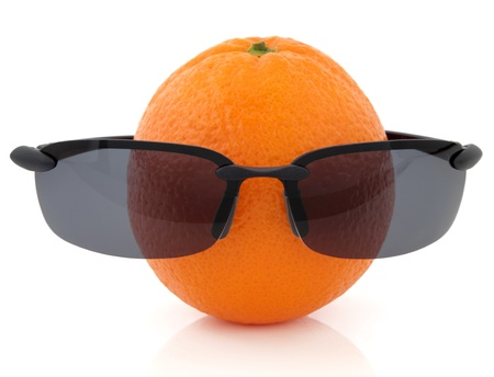 Orange fruit with black sunglasses over white background Stock Photo - 18881717