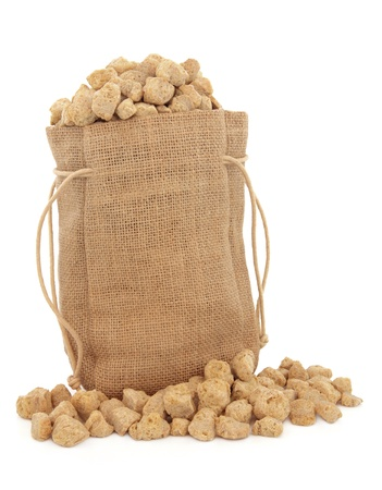Soy  chunks in a hessian sack over white background  Stock Photo - 19021655