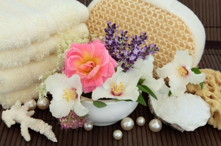 Rose, elderflower, syringa and lavender herb flower blossom, with bath accessories over bamboo Stock Photo - 19013985