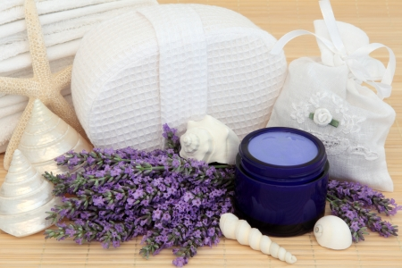 Lavender herb flowers, white linen bag with moisturiser and bathroom accessories Stock Photo - 19021684