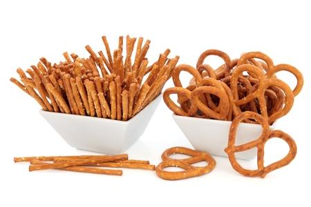 Pretzel snacks in porcelain bowls over white background Stock Photo - 19021583