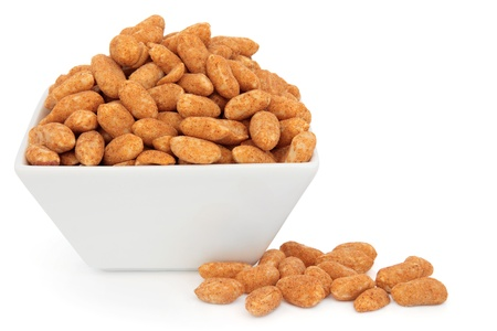 Roasted peanuts in a porcelain dish over white background Stock Photo - 19136245