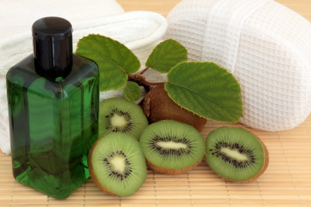Spa and bathroom accessories with kiwi fruit over bamboo background Stock Photo - 19136235