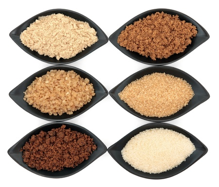 Sugar varieties in black dishes over white background Stock Photo - 19136234