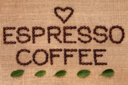 Espresso coffee sign in word form with heart shape and leaf sprigs over hessian background  Stock Photo - 19136243