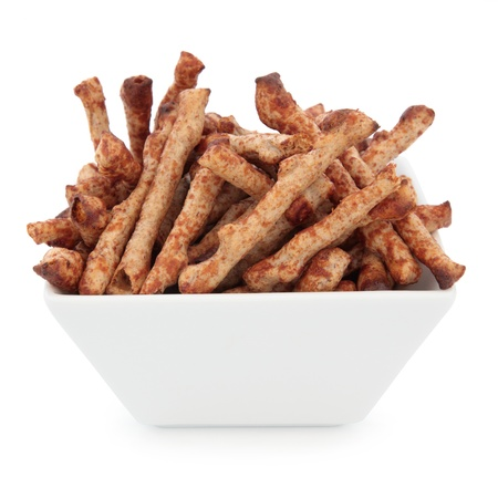 Twiglet savoury beef snacks in a porcelain square dish over white background Stock Photo - 19317705