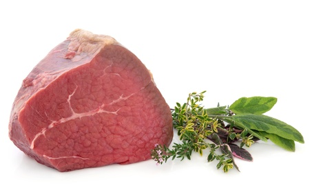 Fillet of beef meat joint with fresh herb sprigs over white background  Stock Photo - 19317707