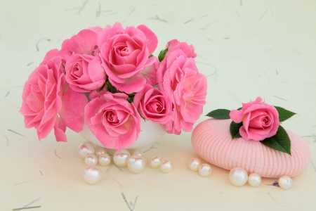 Rose flower arrangement with soap and pearls over mottled cream background  Stock Photo - 19317712