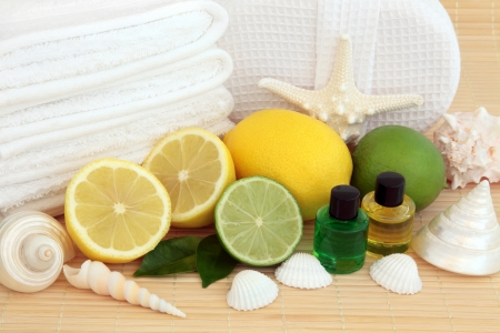Spa and aromatherapy accessories with lemon and lime fruit   Stock Photo - 19317715