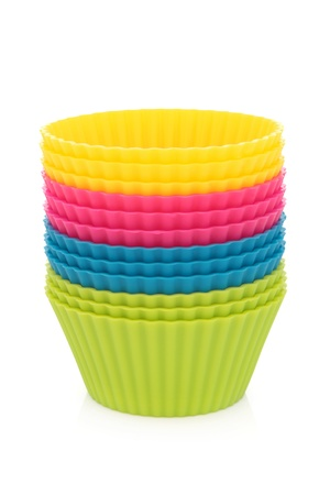 Rubber cupcake pastry cases in a stack over white background Stock Photo - 19317700