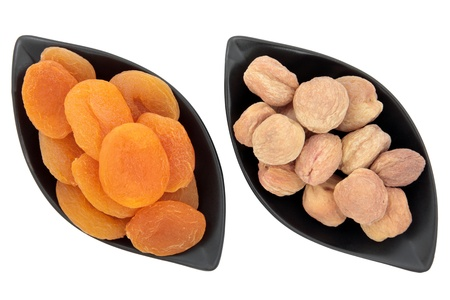 Dried and hunza apricot fruit in black dishes over white background Stock Photo - 19317710