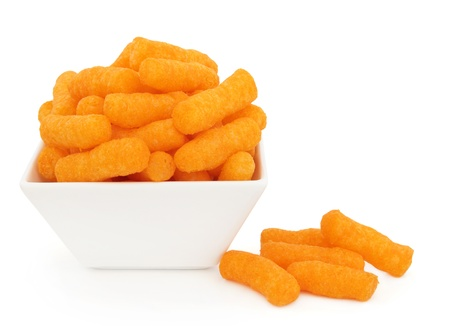 Cheese puff snacks in a porcelain dish over white background  Stock Photo - 19602168