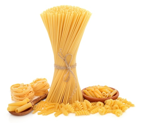 Pasta varieties of spaghetti tied in a bundle, tagliatelle, penne, macaroni, fusilli, rigatoni and fiorelli over white background Stock Photo - 19602172