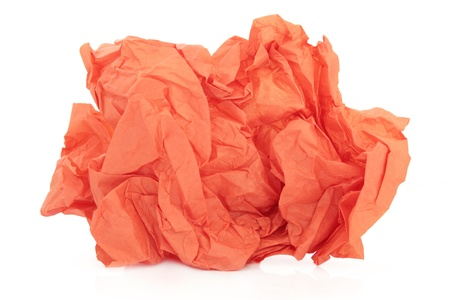 crumpled paper: Crumpled orange tissue paper over white background  Stock Photo