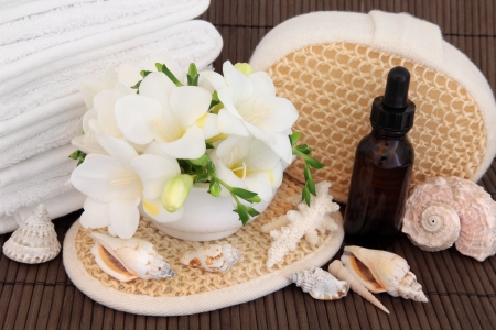 Aromatherapy spa treatment with freesia flower blossom with bathroom accessories and sea shells  Stock Photo - 19754121