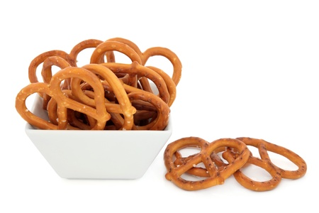 Pretzel snacks in a porcelain bowl over white background  Stock Photo - 19754102