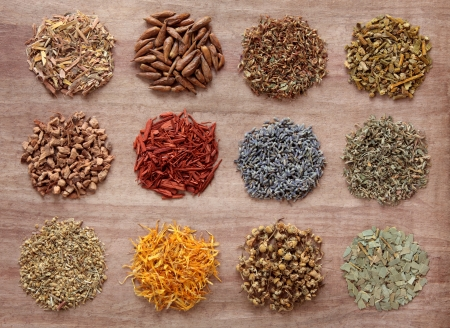 damiana: Medicinal herb selection also used in magical potions over papyrus background  Stock Photo