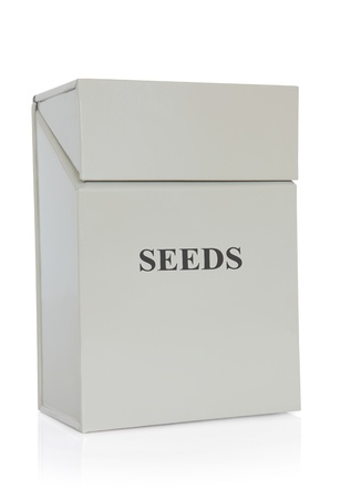 Seed tin in grey metal over white background Stock Photo - 19754090