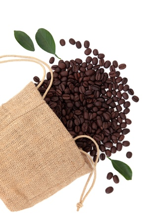 Coffee beans in a hessian sack with leaf sprigs over white background Stock Photo - 19754118