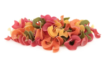semolina pasta: Riccioli pasta made with carrots, tomatoes, spinach and beetroot, semolina and durum wheat over white background